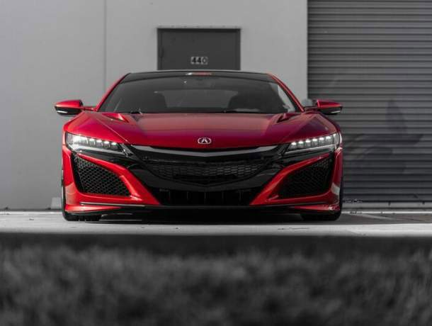 Red Honda NSX shown from the front